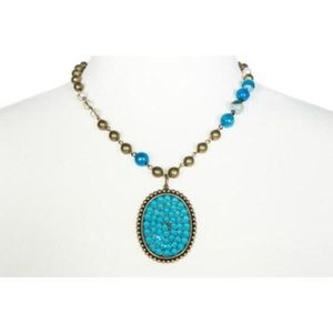 Pink Panache Bronze Necklace with Oval Blue Candy